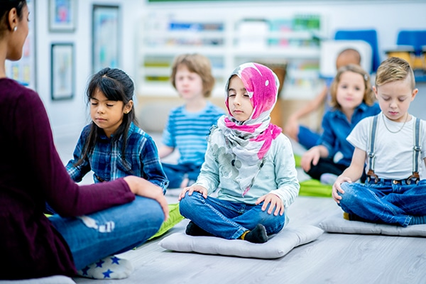 The Importance of Yoga and Meditation in Schools - NJ Family